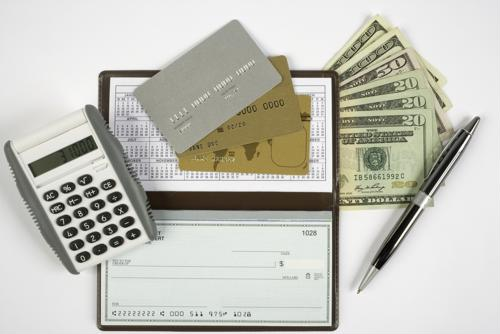 Checkbook with cash, calculator, credit card and pen
