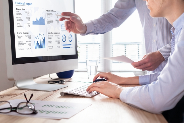 Team of consulting auditors auditing the financial report data of the company