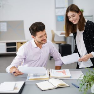 Two Professional Young Businessmen Looking at the Business Document Together with Happy Facial Expressions.; Shutterstock ID 331774367; Team Name: Tech; Job: ; Client/Licensee: ; Other: